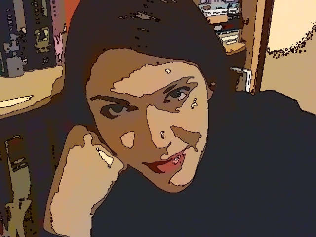 Miss Snarky Pants with makeup and fancy camera filters. She has books behind her...because she is a writer. Original, huh?
