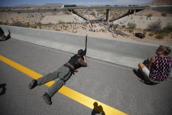 Militia Member Aiming A Gun At Federal Agents